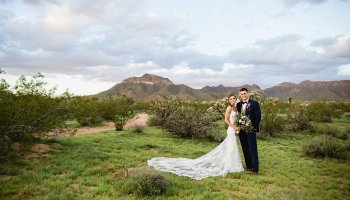 Bride and groom in the desert at their Superstition Manor Wedding by Mesa wedding photographer PMA Photography.