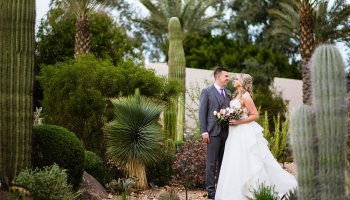 Bride and Groom pose during their The Scottsdale Resort at McCormick Ranch wedding by Arizona wedding photographer PMA Photography.