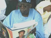 ...Asiwaju Bola Ahmed Tinubu...with a copy of Parrot Xtra Magazine, our sister publication...