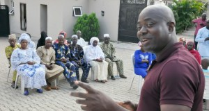 Engineer Seyi Makinde, right, with the pilgrims and others...