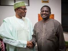 Femi Adesina, right, with his boss, President Muhammadu Buhari...