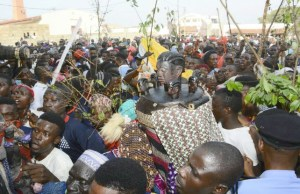 ...a masquerade in Iwo, Osun State, with its followers...