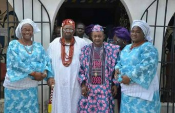 The Alaafin of Oyo with his guest and his wives...