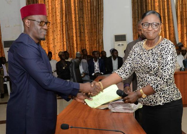 ...the new Head of Service, Mrs Susan Modupe Oluwole, right, being congratulated by Governor Abdulfatah Ahmed...