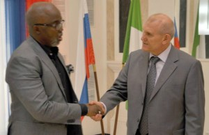 NFF's Amaju Pinnick, left, with His Excellency Nikolay Udovichenko...