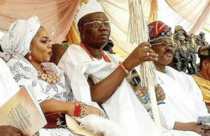 Aare Gani Adams, middle, with his wife and Governor Abiola Ajimobi at the installation...