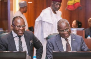 Minister of Works, Power and Housing, Mr Babatunde Fashola, right, with others at the FEC Meeting...