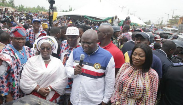 Governor Akinwunmi Ambode of Lagos State, middle, commissioning one of the roads...