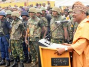 Governor Abiola Ajimobi of Oyo State, right, addressing the joint patrol team...recently..