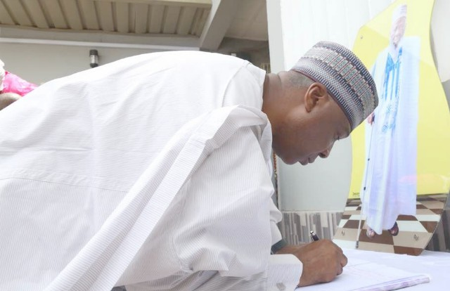 The President of the Senate, Dr Bukola Saraki signing the condolence register at the the home of the late jurist…