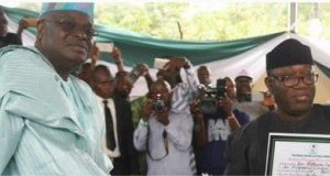 Ekiti's Governor-Elect, Dr Kayode Fayemi, left, receives his Certificate of Return…on Wednesday…