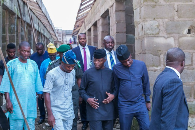 VP Yemi Osinbajo with stakeholders of the community during the inspection of the market…