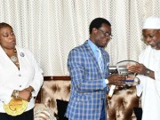 Nigeria Representative and Chairperson Committee on Social Affairs and Health of the African Union Economic, Social and Cultural Council (AU-ECOSOCC), Mr Tunji Asaolu (middle), Presenting an award of good governance on Programme for Infrastructure Development in Africa (PIDA) to Governor State of Osun, Ogbeni Rauf Aregbesola. With them is the Head of Secretariat (AU -ECOSOCC) in Nigeria, Ambassador Chinwe Maduike (left); during the visit…