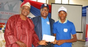 A student gets his cash award...