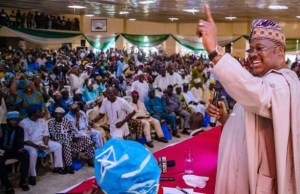 ...Governor Abiola Ajimobi, right, acknowledging his teeming supporters at the venue to the meeting...