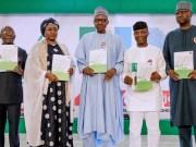 L-R: APC's Chairman, Comrade Adams Oshiomhole, Mrs Aishat Buhari, President Muhammadu Buhari, Professor Yemi Osinbajo...at the event...