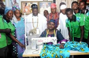 Ambassador Romoke Ayinde, seated, displaying skills to the Olubadan of Ibadanland, Oba Saliu Adetunji and others...