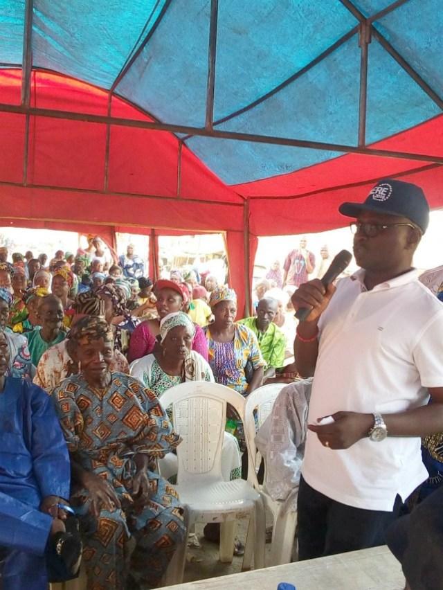 Hon. (Prince) Abdulwasiu Okunola Akere, right, addressing his people
