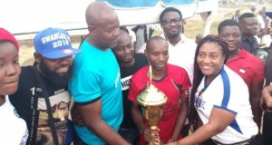 Folarin Familusi and wife presenting trophy to the winners of 2018 SWANLUX Soccer Tourney