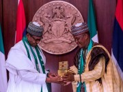 President Buhari receives a presentation from MACBAN National President Alhaji Muhammadu Kiruwa as he receives in audience Leadership of Miyetti Allah Cattle Breeders Association of Nigeria (MACBAN)