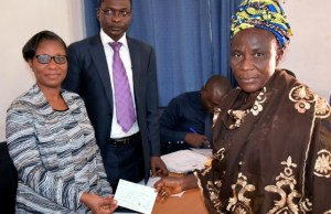 L-R: Acting Permanent Secretary, Office of the Head of Service, Mrs Adejoke Eyitayo, Director Pension and Post Service, Mr Adekunle Adesola while presenting a cheque to one of the beneficiaries, Mrs Kobiowu Simbiat at the Old Ministry of Establishment and Training, Secretariat, Ibadan on Thursday…