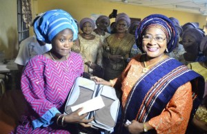 Wife of Osun State Governor, Mrs Kafayat Oyetola (right) presenting gifts to Mother of the first baby of the year 2019, Mrs Olaide Oladosu