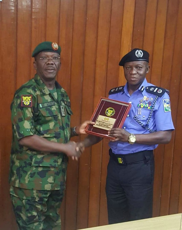 ...Major-General F.O. Azinta, left, with AIG Leye Oyebade...during the visit...