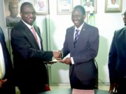 Group Managing Director/CEO, Odu'a Investment Company Limited, Mr Adewale Raji (2nd right) exchanging the signed agreement in respect of The development of Westlink-Iconic Estate in Ibadan, Oyo State with the Chief Executive Officer, Chapter Four Estate Management Limited (CFEML), Mr. Shamsideen Ogunmuyiwa while Financial Director, CFEML, Mr. Niyi Raimi (Left) and Group Head, Property Development and Management, Odu'a, Engr. Tope Arowolo look on