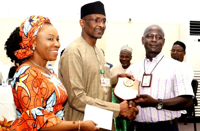 L-R: Mrs Nnenna Akajemeli, National Coordinator, SERVICOM, Mr Bashir Alkali, Director, Finance and Accounts, State House and Mr Yashim Nuhu, a Senior Motor Driver Mechanic, and State House Outstanding Driver Award recipient…
