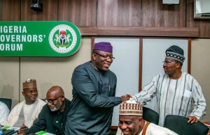 ...Dr Kayode Fayemi, left, being congratulated by the governor of Oyo State, Senator Abiola Ajimobi...
