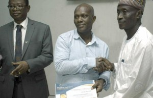 The Representative of the Minister of Niger Delta Affairs and Director, Economic Empowerment Directorate, Mr. Ibrahim Akanya (right) with Professor Ayobami Salami (left), Vice Chancellor, First Technical University (Tech-U), presenting a certificate of completion to one of the beneficiaries at the closing ceremony of a two-week youth empowerment program held at the Tech-U campus in Ibadan last Friday...