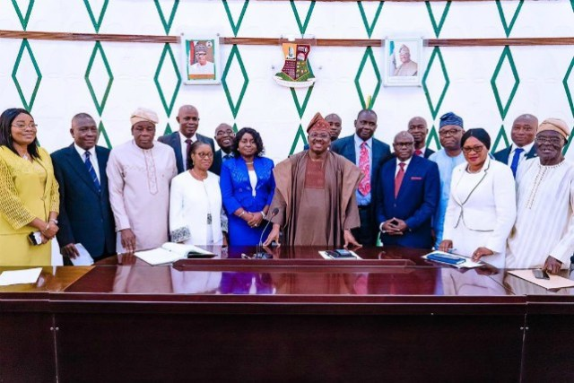 ...Governor Abiola Ajimobi, in a group photograph with the new Permanent Secretaries and others...