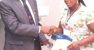 The Vice Chancellor of the First Technical University, Ibadan, Professor Ayobami Salami, left, giving out a certificate to one of the participants at the occasion...