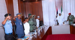 President Muhammadu Buhari with the security chiefs on Thursday in Abuja...