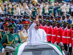 President Muhammadu Buhari...saluting fellow 'countrymen' at the event...