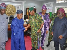 The GOC, Major General Okwudili Fidelis Azinta in a handshake with Osun State Governor, Alhaji Isiaka Adegboyega Oyetola in the governor's office, Osogbo while others look on…