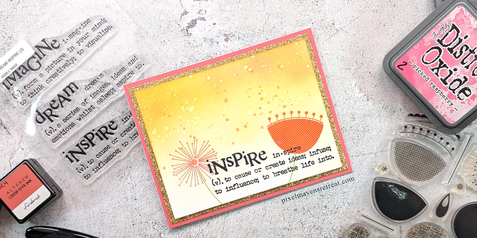 "Greeting card displayed on a stone desktop with crafting supplies. Card is pink, yellow and orange with Mid-Century Modern floral images and a sentiment reading ""inspire""."