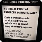 tow away parking sign