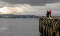 Fishers in Armadale's harbor