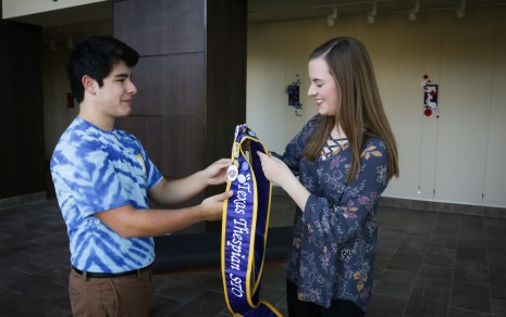 Nick Marquez passing the state thespian officer sash on to Christina Julian