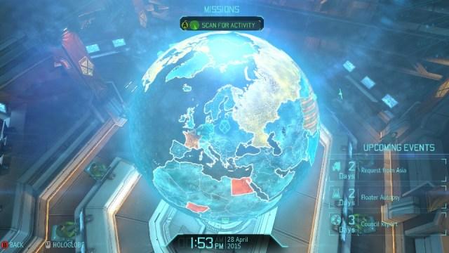 Visão da central de comando com o holograma da Terra