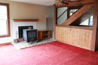 Living Room  Red carpet to be removed, stove to be
