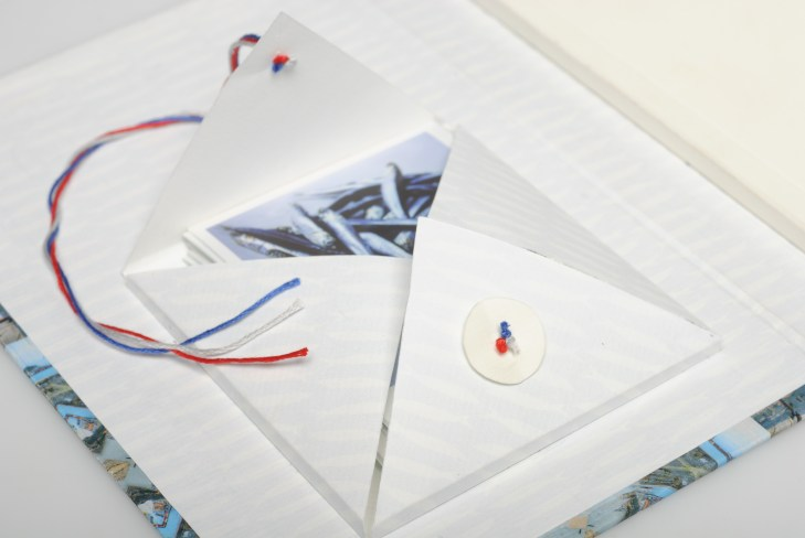 Tasca interna per le polaroid