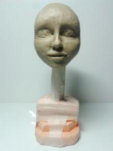 Лепка из пластилина лица куклы.