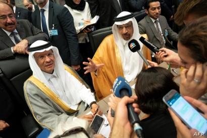 FILE - In this file photo taken July 01, 2019, Saudi Arabia's Energy Minister Khaled al-Falih (R) and Saudi Deputy Oil Minister Prince Abdulaziz bin Salman bin Abdulaziz talk to the press on the sidelines of an oil meeting in Vienna, Austria.