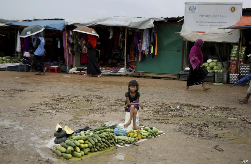 A Rohingya refugee girl sells vegetables in Kutupalong refugee camp, Bangladesh, Aug. 28, 2018.