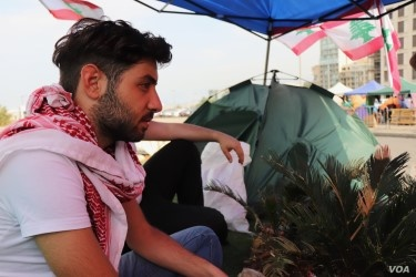 Ayman Debiane, 22, has been living in the protest camp for nearly four weeks, saying corruption in Lebanon is keeping young people out of work and impoverishing the people, pictured in Beirut on Nov. 14, 2019. (Heather Murdock/VOA)