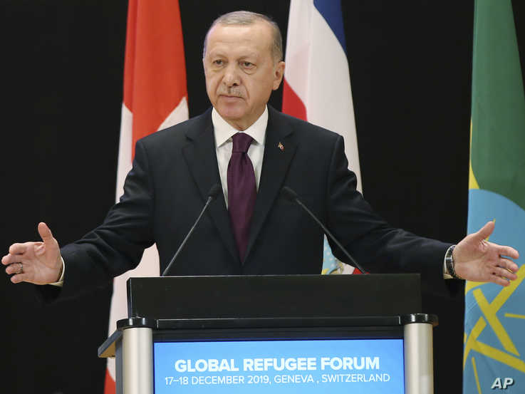 Turkey's President Recep Tayyip Erdogan delivers a speech during the UNHCR - Global Refugee Forum at the European headquarters…