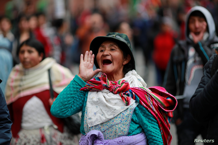 A supporter of former Bolivian President Evo Morales reacts during a protest, in La Paz, Bolivia November 14, 2019. REUTERS…
