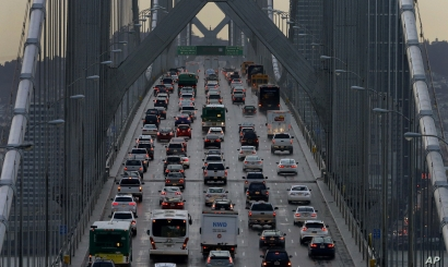 FILE - Vehicles make their way west on Interstate 80 across the San Francisco-Oakland Bay Bridge as seen from Treasure Island in San Francisco, Dec. 10, 2015.